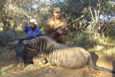 Cliff with Blue Wildebeest at Matoppi Game Farm - 375